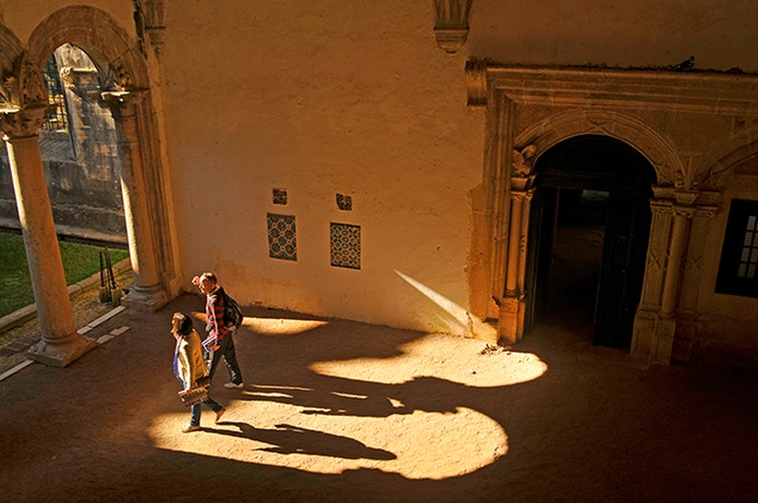 People and shadows inside  Castle Tomar, Portugal